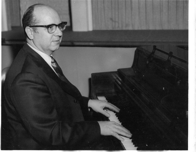 Alan W. Smith at the piano