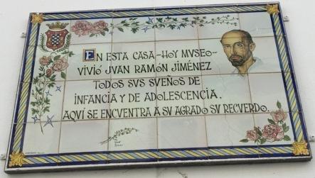 """A plaque in the doorway reads: """"En esta casa -- hoy museo -- vivío Juan Ramón Jiménez todos sus sueños de infancia y de adolescencia (In this house -- now a museum -- Juan Ramón Jiménez experoeinced all his dreams of childhood and adolescence)"""